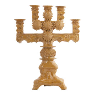 Yellow ceramic five arm candelabra with highly sculpted elements
